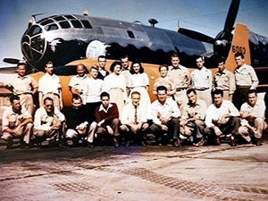 This image shows the NACA Muroc staff from October 1947 in front of the NACA XS-1. In the background is the NACA JTB-29A that carried the XS-1 under its fuselage.