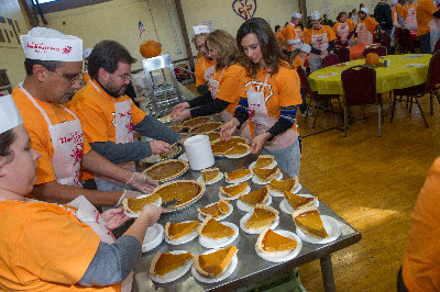 Employees and support staff from Marshall's Office of Human Capital prepare to serve pumpkin pie as part of the Thanksgiving meal at the Downtown Rescue Mission in Huntsville.