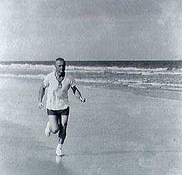 John Glenn runs on the beach at Cape Canaveral.