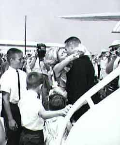 Scott Carpenter's family welcomes him home.