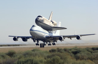 NASA's 747 Shuttle Carrier Aircraft takes off with space shuttle Discovery.