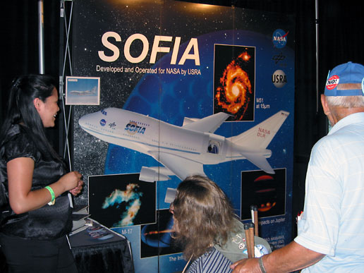 Darlene Mendoza from the Ames Research Center explains NASA's SOFIA mission to sightseers