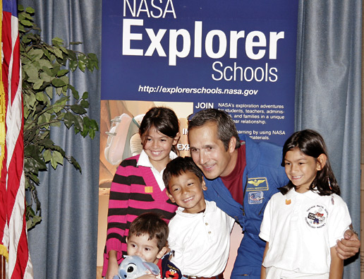 Former astronaut John Herrington visits with students.