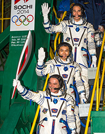 Expedition 38 Crew With Olympic Torch