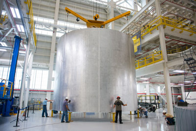 Engineers at NASA's Michoud Assembly Facility transfer a 22-foot-tall barrel section of the SLS core stage from the vertical weld center. The barrel section, above, will be used for the liquid hydrogen tank, which will help power the SLS rocket out of Earth's orbit.