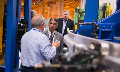 Dr. Michael Gazarik, center, associate administrator of NASA's Space Technology Mission Directorate, visits the NASA Michoud Assembly Facility in New Orleans on Aug. 6.