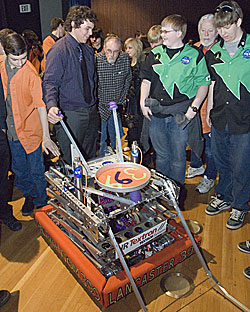 Lancaster High robotics team leader Brad Voracek outlines details of his school's FIRST competition robot to members of the Tehachapi High School robotics team.