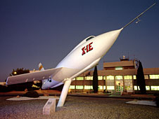Nighttime photograph of X-1E in front of Bldg. 4800