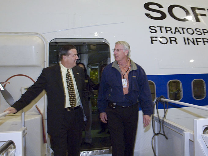 Steven G. Schmidt, director of the Dryden Aircraft Operations Facility in Palmdale, Calif. (right), accompanies Mayor James Ledford of Palmdale as they exit the Stratospheric Observatory for Infrared Astronomy.