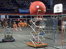 Lancaster Highs robot The Phantom grabs the ball off the rack during the Los Angeles regional competition.