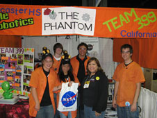 NASA Dryden informal education coordinator Cecelia Cordova (in dark jacket) met with two students from New Zealand (front left) and members of the Dryden-sponsored Lancaster High School Eagle Robotics team that competed in Atlanta.