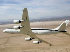 NASA's DC-8 airborne science laboratory banks low over Rogers Dry Lake.