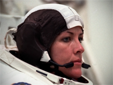 Astronaut Janet L. Kavandi wearing her communication head gear