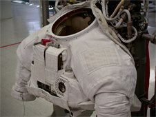 The upper torso of the spacesuit covered with protective cloth layers