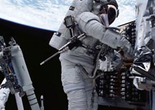 Astronaut Richard M. Linnehan works on the power control unit of the Hubble Space Telescope during a spacewalk