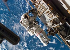 Astronaut Rick Mastracchio outside the space station with Earth behind him
