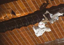 Astronaut Scott Parazynski repairs a damaged solar array on the space station