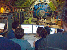 Scientists examine data received during nighttime testing of the SOFIA airborne observatory's telescope.