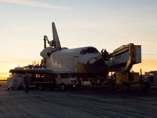 Work gets under way on post-landing operations with Endeavour, preparing to tow it to Dryden.