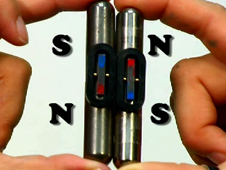 Still from video showing magnets