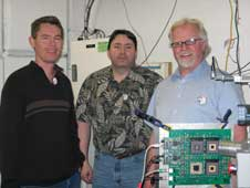 Univ. of Idaho engineers Chad Orbe, Paul Winterrowd, Ron Nelson doing radiation testing of the compression chips at Texas A&M University.