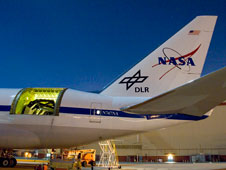The Stratospheric Observatory for Infrared Astronomy's 2.5-meter infrared telescope can be seen in the cavity in the aircraft's rear fuselage during nighttime line operations testing.