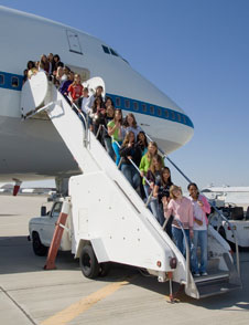 Seventh-grade girls who attended the Tech Trek tour of NASA Dryden Flight Research Center line up on the stairway to NASA's modified Boeing 747 Shuttle Carrier Aircraft.