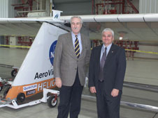 Petersen and then NASA Administrator Sean O'Keefe stand by the Helios Prototype in 2004.