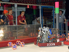Members of Antelope Valley High School's Robolopes robotics team maneuver their robot Kapu during competition at the regional robotics meet sponsored by the FIRST organization March 28 in Las Vegas.