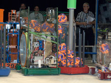 Tehachapi High School's robot dumps a load of balls into an opponents trailer during competition at the Las Vegas regional robotics meet.