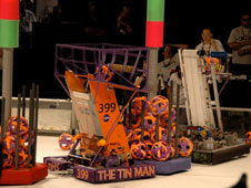 Lancaster High School's Tin Man robot mixes it up against other teams' machines at the FIRST Regional Robotics Meet in Denver.
