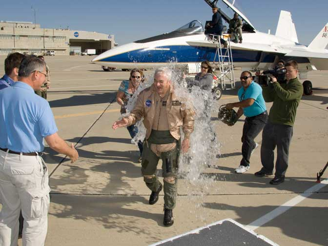 Retiring Center Director Kevin L. Petersen is splashed with buckets of water by Dryden employees following his final flight in the F/A-18.