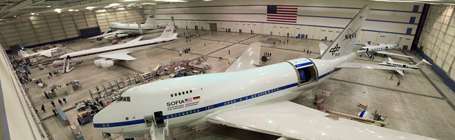Wide view of aircraft in hangar