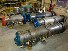 Several GE F-404 engines and sections in NASA Dryden's jet engine shop.