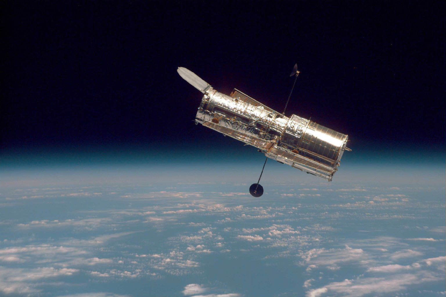 This photograph of NASA's Hubble Space Telescope was taken on the ...