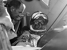 Pilot Scott Crossfield into the cockpit of the X-15 rocket plane before an early test flight.