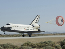 Atlantis lands at Dryden May 24, concluding a successful 13-day mission to service the Hubble Space Telescope.