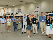 Dryden tour guide Winette Vandam points out one of the center's aircraft for members of the Experimental Aircraft Association President's Circle in Hangar 4802 on May 6 to learn about the cutting-edge research under way at the center.