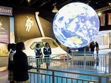 Students watch clouds shift across the globe in real time on Science on a Sphere