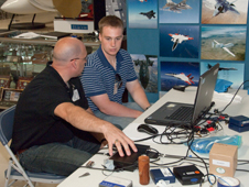 Joseph Gavin of Gulfstream Aerospace and NASA co-op student Thomas Williams monitor sonic boom recording equipment placed in the Edwards Air Force Base Museum for the SonicBOBS calibration flights.