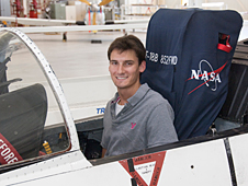 Michigan State University student and NASA intern Scott Buffa sits in the cockpit of an F-18 aircraft at NASA's Dryden Flight Research Center.