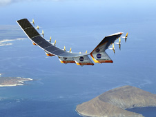 Helios Prototype flying wing over the Hawaiian island of Niihau and Lehua.