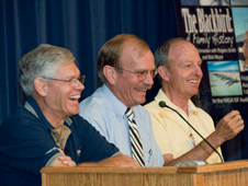 Ed Schneider, Bob Meyer and Rogers Smith share a light moment at a presentation about the Blackbirds Aug. 14 at Dryden.