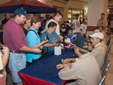 People waited in line for autographs from former and current NASA flight crew members at the JetHawks Aerospace Appreciation Night Aug. 15.