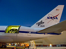 The SOFIA airborne observatory's 2.5-meter infrared telescope peers out from the SOFIA 747SP's rear fuselage.