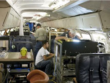 The interior of NASA's DC-8 flying laboratory is loaded with instruments bound for the Antarctic during the fall 2009 Operation Ice Bridge mission