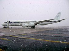 NASA's DC-8 flying science laboratory being grounded by a snowstorm Oct. 19 at its staging base in Punta Arenas, Chile