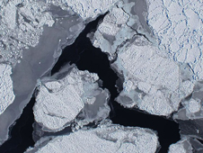 Ice shelf extending over the Amundsen Sea off Antarctica taken by the downward-looking Digital Mapping System camera.