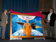 NASA Administrator Charlie Bolden, left, and Dryden acting director David McBride unveil a new portrait of Apollo 11 astronaut and former Dryden research pilot Neil Armstrong during Bolden's Oct. 30 town hall with Dryden employees.