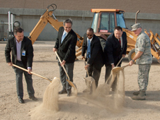 The ceremonial first shovels full of dirt for the new Dryden Consolidated Information Technology Center were dug by, from left, Allen Olsen, Southwestern Dakotah Inc.; David McBride, acting Dryden center director; Jerry Davis, deputy chief information officer of IT Security at NASA Headquarters; Frank Bellinger, director of Facilities Engineering and Real Property at NASA Headquarters; and Col. Jerry L. Gandy, 95th Air Base Wing Commander at Edwards Air Force Base.